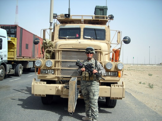 "Master Sgt. Renee Fullard, 386th Expeditionary Logistics Readiness Squadron, geared up to go outside the wire in front her truck ""Notorious"" during her deployment to Iraq as a combat trucker in 2010. Fullard is deployed to the 386th Air Expeditionary Wing from Pope Field N.C. serving as the night shift supervisor of the vehicle operations control center. (Courtesy Photo)"