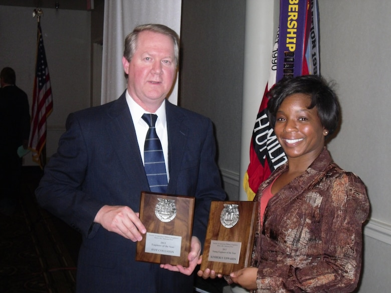 Huntsville Center's Jeff Coulston and Kim Edwards show off their awards after the Society of American Military Engineers Huntsville Post ceremony Feb. 21.
