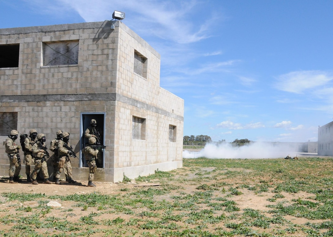 U.K. marines from the Force Protection Group Royal Marine prepare to evacuate a building during exercise Lisa Azul aboard Naval Station Rota, Spain. U.S., Spanish and U.K. marines participated in Lisa Azul, a trilateral exercise that began March 4.