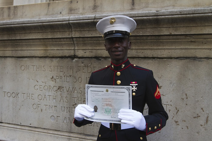 Lance Cpl. Torffic Hassan, a Marine reservist with 6th Communications Battalion, became a naturalized U.S. citizen March 22 during a Naturalization Ceremony at the Federal Hall National Memorial, here.  Hassan immigrated to the United States four years ago from the Republic of Ghana, West Africa.