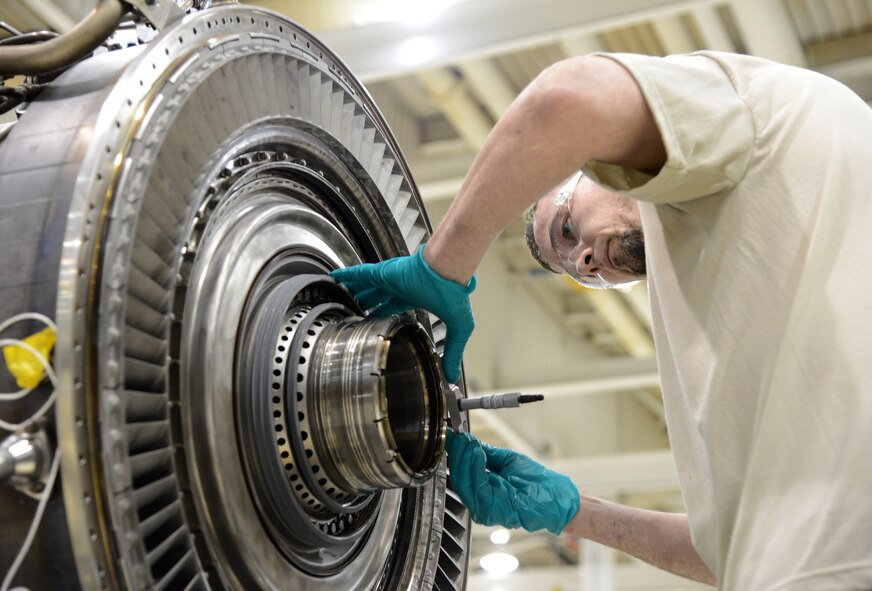 Jeremy Russell installs a No. 4 bearing race in the High Press Turbine of an F-108 engine. Mr. Russell is an engine mechanic with the 546th Propulsion Maintenance Squadron. (Air Force photos by Kelly White)