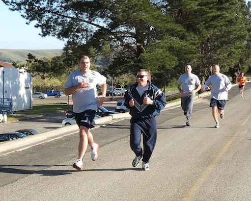 Master Sgt. Kevin Wallace, 366th Fighter Wing Public Affairs superintendent, and Damage Controlman Chief Bill Dooley finish a 5-kilometer run during Chief Petty Officers Academy at Coast Guard Training Center Petaluma, Calif., Feb. 20, 2013. Wallace and his 64 Coast Guard shipmates, four Navy shipmates and three fellow Air Force master sergeants of Class 193 graduated CPOA, March 15. (U.S. Air Force photo/Chief Petty Officer Brian Koji)
