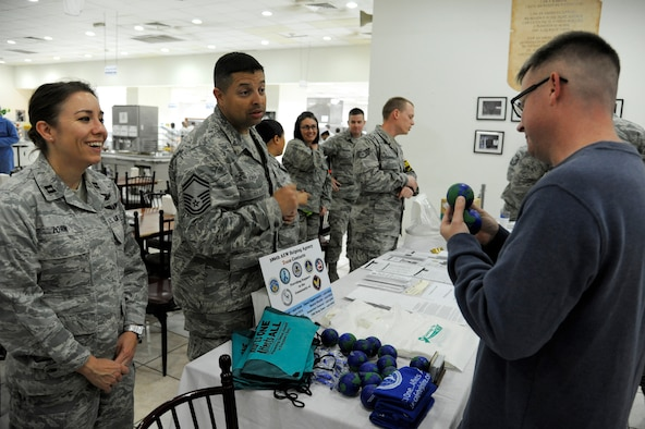 Capt. Bridget Zorn, 386th Air Expeditionary Wing, Sexual Assault Response Coordinator and other Helping Agency contacts provide information to service members at the 386 AEW Care Fair Feb. 15, 2013. Capt. Zorn manages and implements the wing's Sexual Assault Prevention and Response Program and serves as the designated program manager for victim support services. (U.S. Air Force photo by Staff Sgt. Austin Knox)
