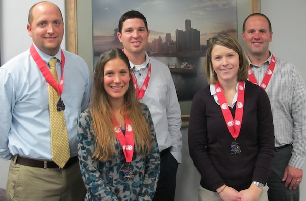 District employees pose with their medals after participating in the 35th Annual Detroit Free Press/Talmer Bank Marathon. The team finished 94th out of 535 entrants.