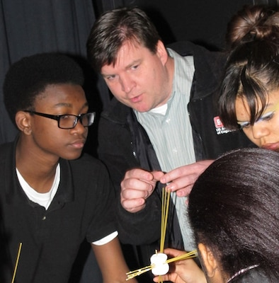 Jason Page, Huntsville Center Engineering Directorate, guides Science Technology Engineering and Math students from Johnson High School in an engineering task during Engineer Week.