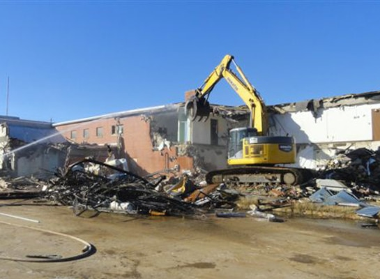 Workers destroy the Tuscaloosa Army Reserve Center which saw extensive damage by a tornado that ripped through Tuscaloosa, Ala., in April 2011. A new $13 million, 67,0000 square foot facility replaced the old facility.