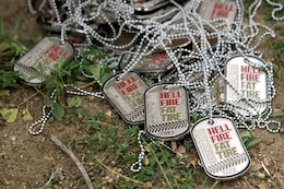 Military and civilian mountain bikers received souvenir dog tags for participating for competing in the first Hell Fire Fat Tire Bike Race here March 23. The bikers raced through 13 and 23-mile courses and traveled over terrain ranging from sea-level to 600 feet in elevation.
