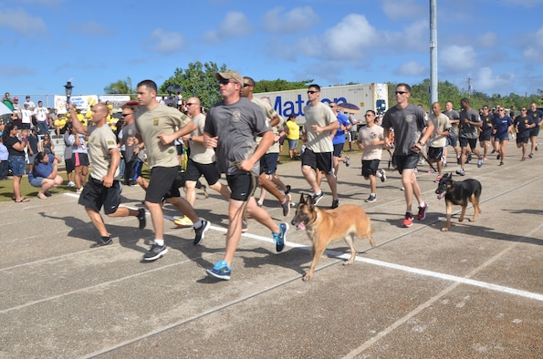 Members from the 736th Security Force Squadron run with the torch during the 37th Annual Special Olympics of Guam Track and Field event at Okkodo High School in Dededo, Guam, March 23, 2013.  More than 300 service members from all military branches came together to support Special Olympic athletes in a variety of Olympic-type sports for children and adults with intellectual disabilities, giving them continuing opportunities to develop physical fitness and demonstrate courage.  (U.S. Air Force photo/Staff Sgt. Veronica McMahon/Released)