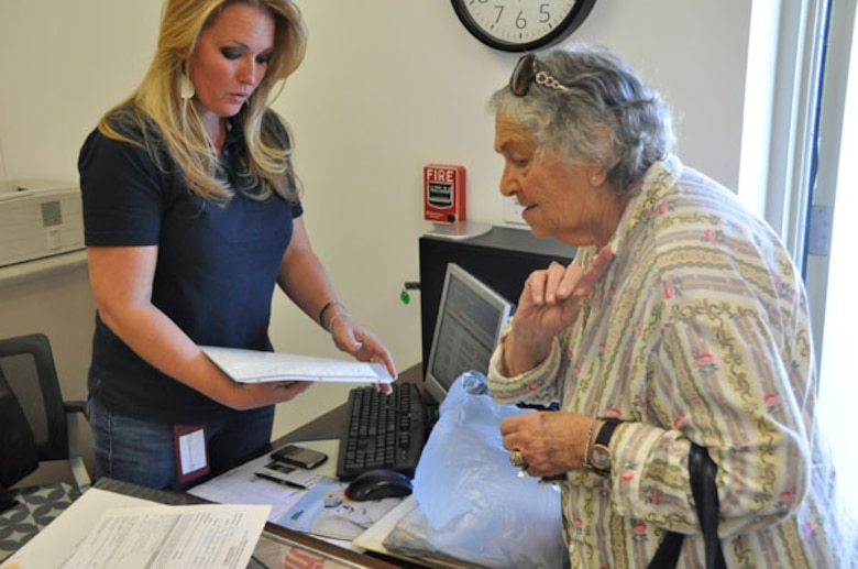 Catherine Pritchett,left, senior assistant to the Inland Valley Development Agency executive director, checks in items donated to the museum.