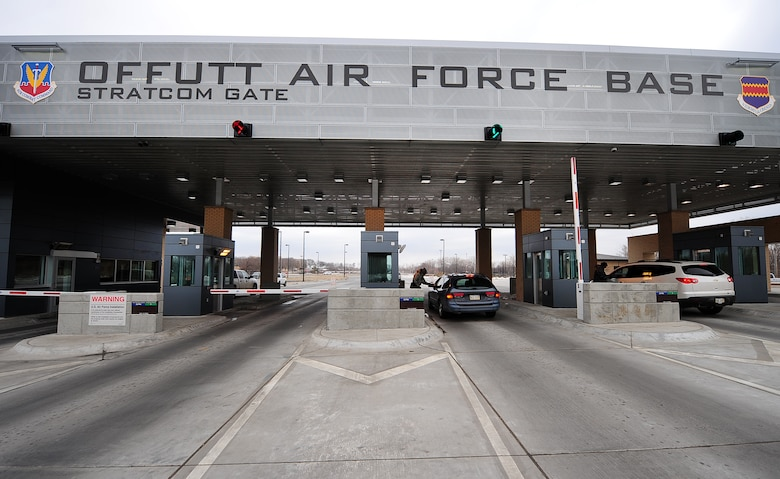 U.S. Air Force Airman 1st Class Keith Thompson, 55th Security Forces Squadron, checks Identification at the newly remodeled and expanded Strategic Command Gate on Offutt Air Force Base, Neb., March 5. Thousands of vehicles move through the three main entry gates each day. Airman Thompson along with colleagues ensure smooth and secure access to Offutt. (U.S. Air Force Photo by Josh Plueger/Released)