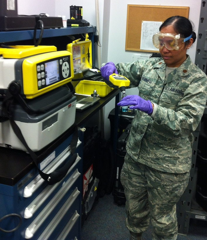 Maj. Elisa A. Hammer, bioenvironmental engineer, 779th Aerospace Medical Squadron, 79th Medical Wing, simulates the use of the Hazardous Air Pollutants on Site apparatus, which identifies an unknown chemical and quantifies its potential exposure to Joint Base Andrews or to neighboring communities.  A native of Hawaii, Hammer brought her passion for the environment to the Air Force, where she has served in the bioenvironmental career for 12 years. (Courtesy photo)