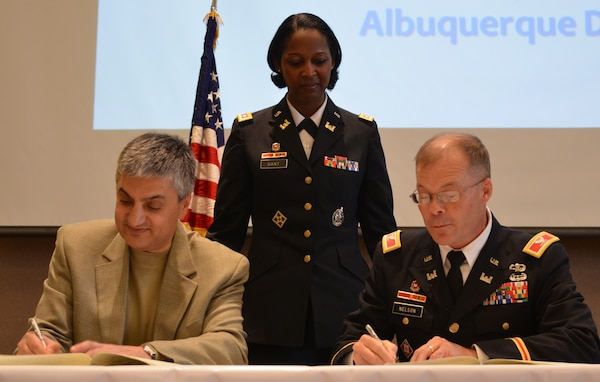 ALBUQUERQUE, N.M., -- Mr.Chaouki Abdallah, provost, University of New Mexico (left); Lt. Col. Antoinette Gant, commander, Albuquerque District, and Col. Andrew Nelson, deputy commander, South Pacific Division, participate in the Memorandum of Agreement Signing Ceremony. The District and UNM will work together to promote and encourage the study of STEM fields: Science, Technology, Engineers and Math.
