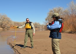 Socorro, N.M., -- Ryan Gronewold, Albuquerque District's Rio Grande coordinator, measures the water level in the Rio Grande with a calibrated survey rod. Amanda Green, a Department of the Army Intern in the District, records the data.