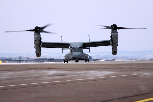"Arriving for a capabilities demonstration, scheduled for the next few days in Stuttgart, Germany, an MV-22B Osprey from the Marine Medium Tiltrotor Squadron 266 (Reinforced), II Marine Expeditionary Force, Camp Lejeune, N.C., ""taxis"" the runway at Stuttgart Army Airfield.The MV-22B Osprey has a unique tilt-rotor capability that allows it to fly twice as fast, twice as high, and six times farther than legacy medium-lift helicopters, while carrying three times more weight."