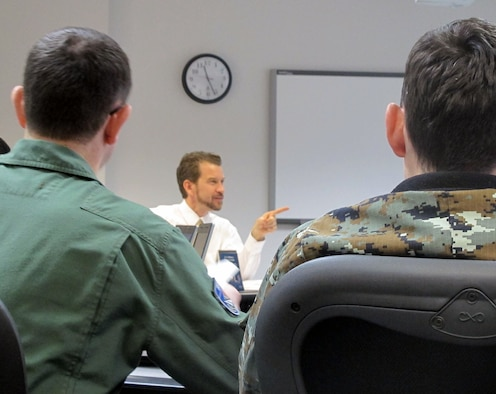 """Dr. Brian Selmeski, Air Force Culture and Language Center chief of plans and policy, presents to a class of Air Command and Staff College international students March 13. Dr. Selmeski's course, """"Understanding and Working with the U.S. Military,"""" is the first graduate-level Air Command and Staff College elective to focus on the unique culture of the U.S. military. (Courtesy photo)"""