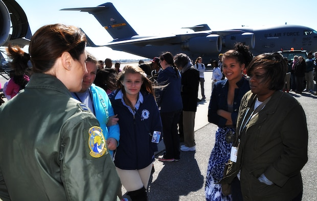 Capt. Molly Sanford, 315th Airlift Wing pilot, talks to girls on the flight line just before a tour of the C-17 Globemaster III aircraft at Joint Base Charleston, SC, March 26. Nearly 140 eighth and ninth grade-girls from Charleston area schools visited to learn about jobs in aviation. (U.S. Air Force photo/Tech. Sgt. Scott Mathews)