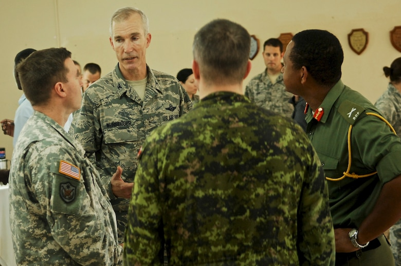 Col. Stuart Weinberger, Task Force Mahogany commander, speaks with service members from the U.S., Canada, and Belize during the New Horizons 2013 opening ceremony March 25, 2013, at Ladyville Technical High School. New Horizons is an exercise led by U.S. Southern Command that provides medical and dental treatment as well as constructs school structures throughout Belize. It gives U.S., Belizean and Canadian service members the opportunity to train side-by-side in an exercise setting, in order to be prepared to meet future challenges when and where needed. (U.S. Air Force photo/Master Sgt. James Law)