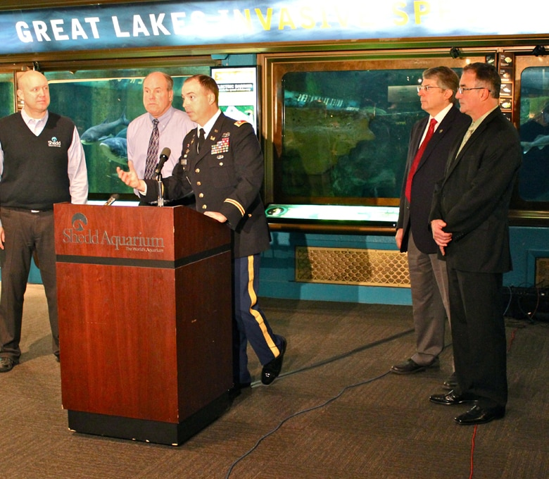 Chicago District Deputy Commander Lt. Col. Jim Schreiner answers media questions at press conference to introduce three new bighead carp to the Invasive Species Exhibit at the Shedd Aquarium, Chicago, Ill., Dec. 20, 2012. 