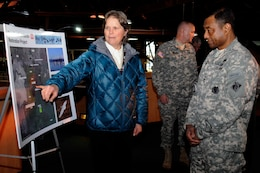 Karen Rippey, San Francisco District, briefs Lieutenant General Thomas P. Bostick, Commanding General and Chief of Engineers, on the Napa Salt Marsh Restoration during his tour of the Bay Model Visitor Center in Sausalito, CA as part of his visit of the district on Jan. 17.