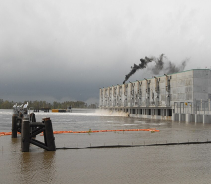 The West Closure Complex in full form operating during Hurricane Isaac. Located approximately one half mile south of the confluence of the Harvey and Algiers canals on the Gulf Intracoastal Waterway, the approximately $1 billion project reduces the risk associated with storm surge for residences and businesses in three parishes on the west bank of the Mississippi River: Orleans, Jefferson and Plaquemines parishes.