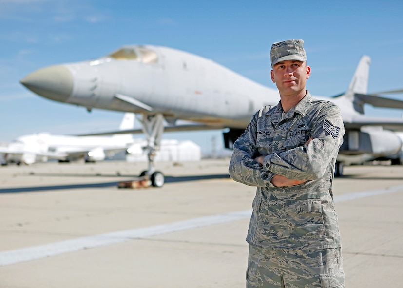 Tech. Sgt. Chad McBunch, 31st Test and Evaluation Squadron B-1 crew chief, stands in front of one of the first B-1s he worked on as a first-term Airman upon arriving at Edwards as a dedicated crew chief in 2002. (U.S. Air Force photo by Jet Fabara)
