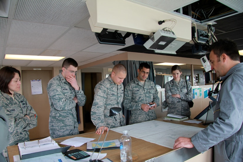 Jeff Hall (right), the incoming first mate on the USNS Soderman (T-AKR 317), explains how ships still use paper navigation charts as backups to the ship's Global Positioning System, to (left to right) Capt. Rebecca Logan, 2nd Lt. Dan Musleve, 2nd Lt. David Loska, 2nd Lt. Andrew Palmer and Capt. Juliana D'Amore, all from the 628th Logistics Readiness Squadron. The Airmen are members of the Charleston Logistics Officer Association which toured the ship March 22, 2013, at Joint Base Charleston – Weapons Station, S.C. The Logistics Officer Association is comprised of Air Force maintenance and Logistics Readiness officers and civilians from the JB Charleston. They toured the Soderman to get a glimpse of the diversity of Charleston's logistics capabilities.  The Soderman is a 950 foot, large, medium speed roll-on/roll-off ship that can carry the equivalent of 225 C-17 loads of cargo. It is one of eight Watson-class ships that are pre-positioned around the globe with nearly everything an Army or Marine contingent needs to begin operations. The ships return to port in the United States every one to three years, and Joint Base Charleston is the sole restocking point for the ships. (U.S. Air Force photo / 1st Lt. Adrianne Schilling