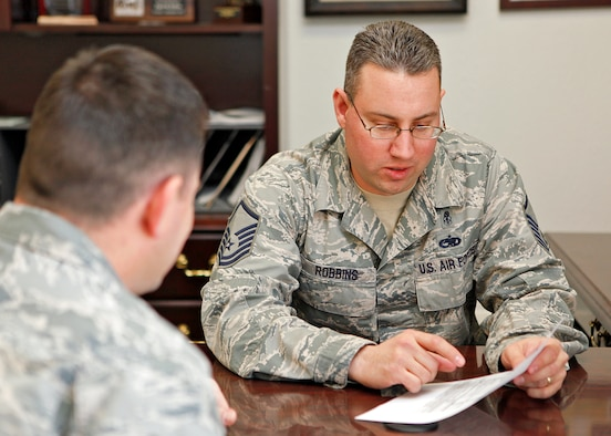 Master Sgt. Erik Robbins, 412th Test Wing career assistance advisor, goes over a list of available career options with a young Airman. Sergeant Robbins is located near the First Term Airman Center and is there to provide career assistance to Airmen who have questions about retention, cross training, or changing jobs. (U.S. Air Force photo by Jet Fabara)