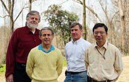(From left to right) David King, Ph.D., Zeki Dmemirbilek, Don Ward and Lihwa Lin, are the team members performing the computer modeling efforts in Vicksburg, Miss. The end result will assist Norfolk District engineers with designing a jetty that will maximize the benefits within the alloted $3.6 million to design and build it for the residents Tangier, Va.