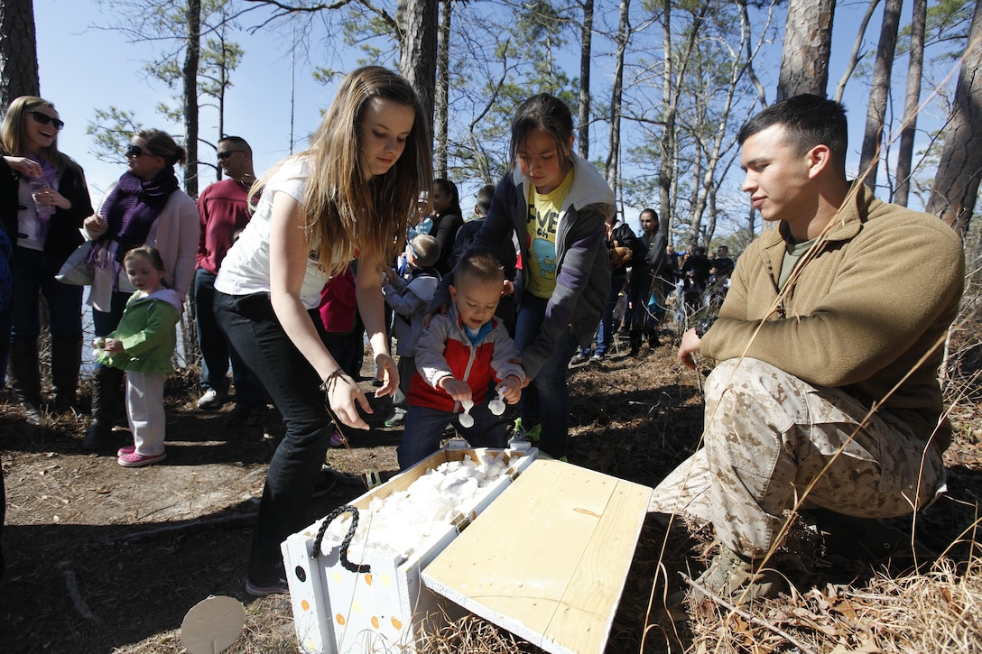 MARINE CORPS AIR STATION CHERRY POINT, N.C. (130325) – Children grab bad bunny bombs at the Marine Aircraft Group 14 Easter extravaganza at the Shady Grove A camping area at Cherry Point March 23. The bad bunny bombs were flour wrapped in tissue that made a sizeable puff on impact.