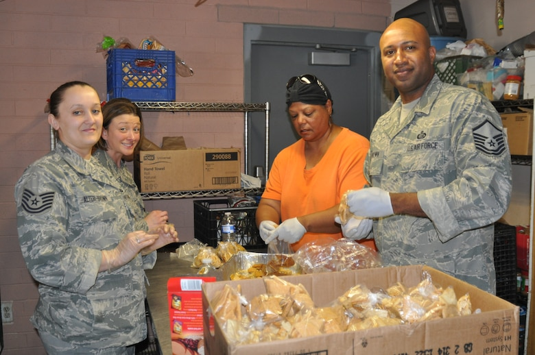 Tech. Sgt. Tiffany Alteri-Brown, Tech. Sgt. Linda Hodgson, Ms. Mary -Claire Avery and Master Sgt. Donnie Brown, all from 12th Air Force (Air Forces Southern), prepare sack lunches for homeless individuals at the Casa Maria Soup Kitchen in Tucson, Ariz., March 28. Over the course of 2-days, members of the organization put together approximately 900 sack lunches, distributed 200 bags of food for needy families, and served more that 400 cups of soup. (USAF photo by Master Sgt. Kelly Ogden/Released).