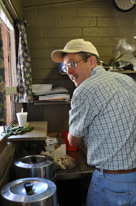 Donald Bullington, 12th Air Force (Air Forces Southern) Director, Force Protection, serves soup to homeless individuals at the Casa Maria Soup Kitchen in Tucson, Ariz., March 28. Over the course of 2-days, members of the organization put together approximately 900 sack lunches, distributed 200 bags of food for needy families, and served more that 400 cups of soup. (USAF photo by Master Sgt. Kelly Ogden/Released).