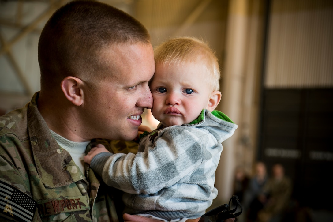 Airman 1st Class Alex Newport hugs his son, Jett, March 26, 2013, at Moody Air Force Base, Ga. Newport and approximately 350 Airmen left Moody AFB for a six-month deployment to Southwest Asia. Newport is assigned to the 74th Aircraft Maintenance Unit. (U.S. Air Force photo/Staff Sgt. Jamal D. Sutter)