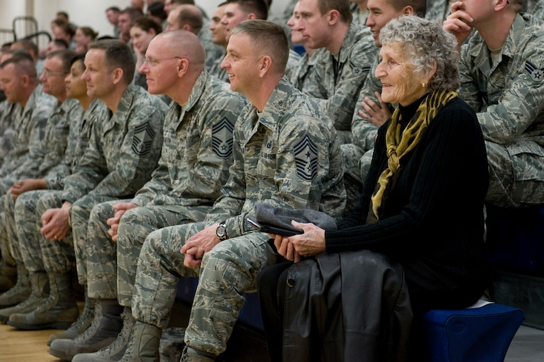 Kathleen McCoy, wife of retired Chief Master Sgt. of the Air Force James M. McCoy, sits next to Chief Master Sgt. William Ward, 460th Space Wing command chief, at an enlisted call March 26, 2013, at Buckley Air Force Base, Colo. McCoy traveled with her husband who has given speeches across the Air Force encouraging Airmen during the difficult times caused by sequestration. (U.S. Air Force photo by Senior Airman Phillip Houk/Released)