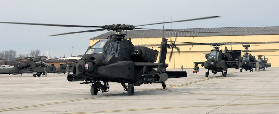 U.S. Army AH-64 Apache Longbows pilots from the 1-135th Attack Reconnaissance Battalion at Whiteman Air Force Base, Mo., prepare March 27, 2013, for their deployment to Afghanistan. The Apaches carry three weapons systems, including a state-of-the-art Hellfire missile that can be laser-guided or radar-guided. (U.S. Air Force photo by Airman 1st Class Shelby R. Orozco/Released)