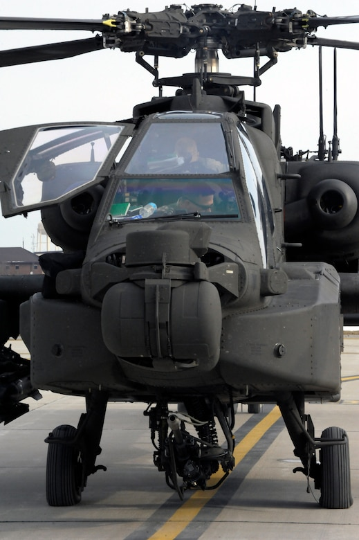 U.S. Army AH-64 Apache Longbow pilots from the 1-135th Attack Reconnaissance Battalion at Whiteman Air Force Base, Mo., prepare March 27, 2013, for their deployment to Afghanistan. The Apache Longbow is the most modernized attack helicopter in the world. (U.S. Air Force photo by Airman 1st Class Shelby R. Orozco/Released)