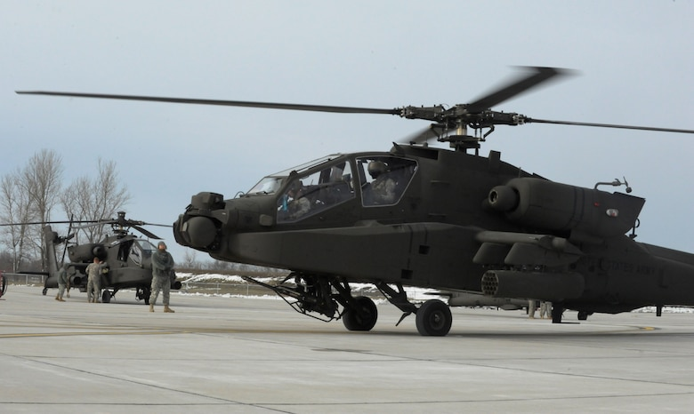 U.S. Army AH-64 Apache Longbows and pilots from the 1-135th Attack Reconnaissance Battalion at Whiteman Air Force Base, Mo., prepare March 27, 2013, for their deployment to Afghanistan. The Apaches first came to Whiteman AFB in 2002. (U.S. Air Force photo by Airman 1st Class Shelby R. Orozco/Released)