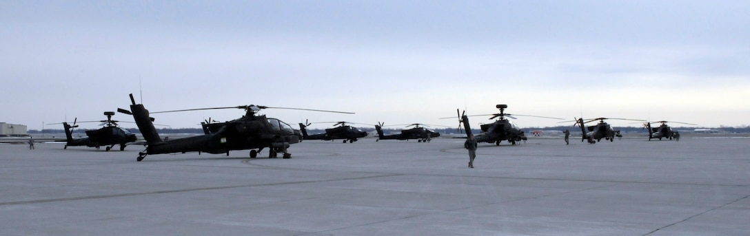 U.S. Army Ah-64 Apache Longbows from the 1-135th Attack Reconnaissance Battalion at Whiteman Air Force Base, Mo., prepare March 27, 2013, for their deployment to Afghanistan. The aircraft will stop in Texas for more training before making their way to Afghanistan. (U.S. Air Force photo by Airman 1st Class Shelby R. Orozco/Released)