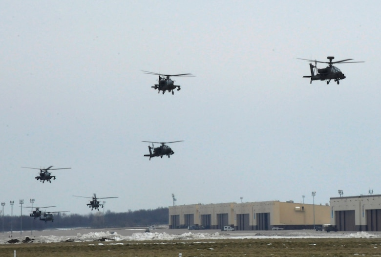 U.S. Army AH-64 Apache Longbows from the 1-135th Attack Reconnaissance Battalion at Whiteman Air Force Base, Mo., leave March 27, 2013, for their deployment to Afghanistan. More than 300 Soldiers from the 1-135th ARB deployed with the aircraft. (U.S. Air Force photo by Airman 1st Class Shelby R. Orozco/Released)