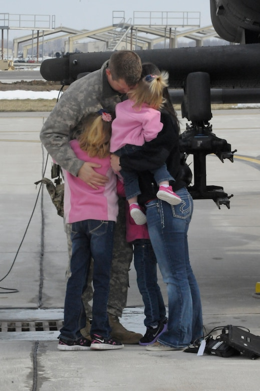 U.S. Army Chief Warrant Officer 3 Marcus Moore with the 1-135th Attack Reconnaissance Battalion at Whiteman Air Force Base, Mo., says goodbye to his family March 27, 2013, before his deployment to Afghanistan. Moore and his counterparts will be deployed for more than a year. (U.S. Air Force photo by Airman 1st Class Shelby R. Orozco/Released)