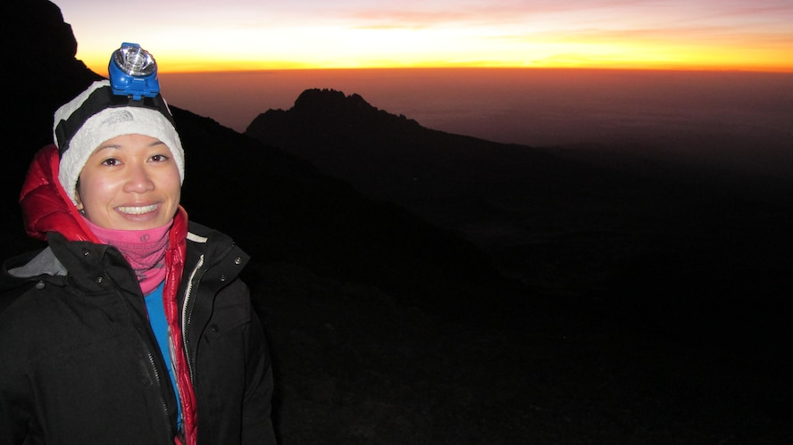 1st Lt. Diana Wong, assigned to the 509th Force Support Squadron at Whiteman Air Force Base, Mo., takes a moment to appreciate the sunrise on Mount Kilimanjaro in Tanzania, Feb. 11, 2013. On the last day of the hike, the group set off at 11:30 p.m. to make it to the peak nine hours later to catch the view. (Courtesy photo/Released)