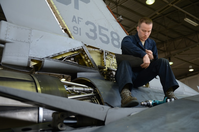 SPANGDAHLEM AIR BASE, Germany – U.S. Air Force Senior Airman Todd Hughes, 52nd Equipment Maintenance Squadron inspection team member from Williamsport, Pa., places rivets on a U.S. Air Force F-16 Fighting Falcon fighter aircraft panel March 27, 2013. Technicians remove the panels to reveal the aircraft's internal workings prior to beginning an inspection. (U.S. Air Force photo by Airman 1st Class Gustavo Castillo/Released)