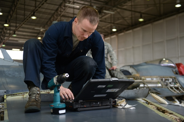 SPANGDAHLEM AIR BASE, Germany – U.S. Air Force Senior Airman Todd Hughes, 52nd Equipment Maintenance Squadron inspection team member from Williamsport, Pa., reviews instructions for replacing panels on a U.S. Air Force F-16 Fighting Falcon fighter aircraft March 27, 2013. U.S. Air Force guidelines require Hughes to review the instructions prior to performing maintenance to be sure the aircraft is safe for flight. (U.S. Air Force photo by Airman 1st Class Gustavo Castillo/Released)