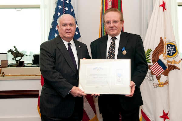 Under Secretary of the Army Dr. Joe Westphal (left) presents medal to Dr. Eugene Stakhiv (right).