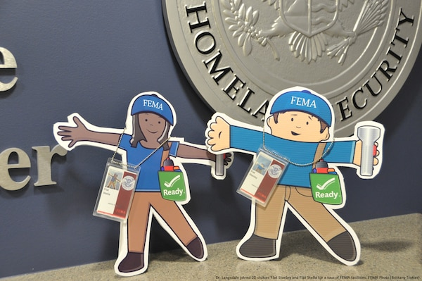 Graphic of Flat Stanley and Flat Stella's first day at FEMA underway, they take a tour of the National Response Coordination Center located at FEMA Headquarters. FEMA Photo (Brittany Trotter).