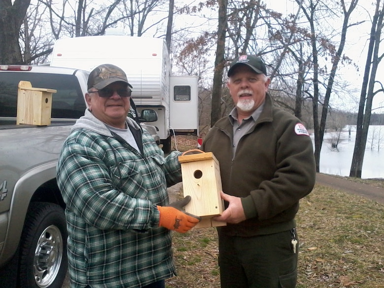 Clearwater Lake Park Ranger Don Henson (right) accepts a donation of 32 bluebird houses from a long time camper, Roy Jennings of Park Hills, Mo.