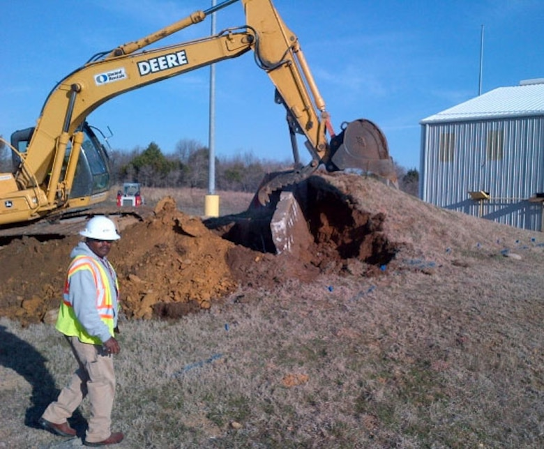 Workers remove an underground safety shelter at McAlester Army Ammunition Plant, Okla. The Center's Facility Reduction Program manages the project.