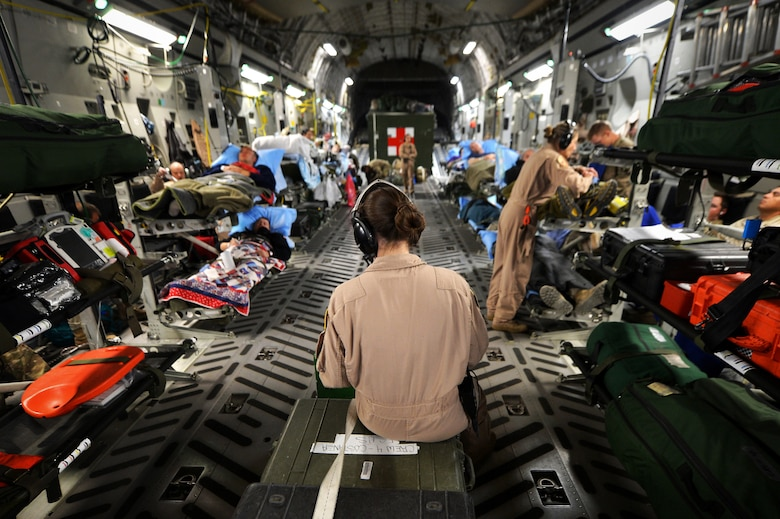 Members of the of a 455th Expeditionary Aeromedical Evacuation Squadron Critical Care Air Transport Team assist patients on a C-17 Globemaster III medical transport flight, out of Bagram Airfield, Afghanistan, March 21, 2013. Air Force Medicine is expanding aeromedical evacuation and CCATT capacity as it prepares to deliver medical support in future conflicts. (U.S. Air Force photo by Senior Airman Chris Willis)