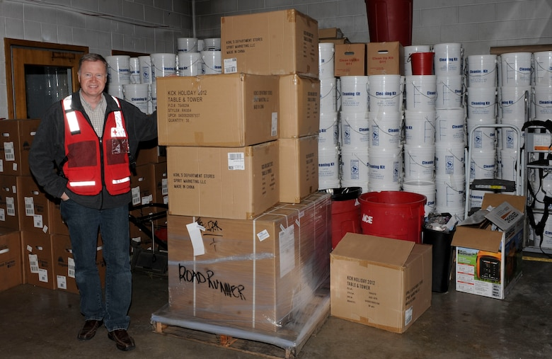 Dan Kuecker, American Red Cross Regional Emergency Services director, displays the recent supplies received for future emergencies at the Black Hills Area Chapter of the American Red Cross in Rapid City, S.D., March 22, 2013. The new supplies included a new four-wheel drive truck, electric generators, buckets of non-perishable meals, and water purification systems. (U.S. Air Force photo by Airman 1st Class Anania Tekurio/Released)
