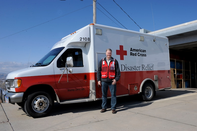 Dan Kuecker, American Red Cross Regional Emergency Services director, stands next to an emergency response vehicle in front of the Black Hills Area Chapter of the ARC in Rapid City, S.D., March 22, 2013. The Black Hills Area Chapter continually seeks volunteers to support efforts during times of crisis. (U.S. Air Force photo by Airman 1st Class Anania Tekurio/Released)