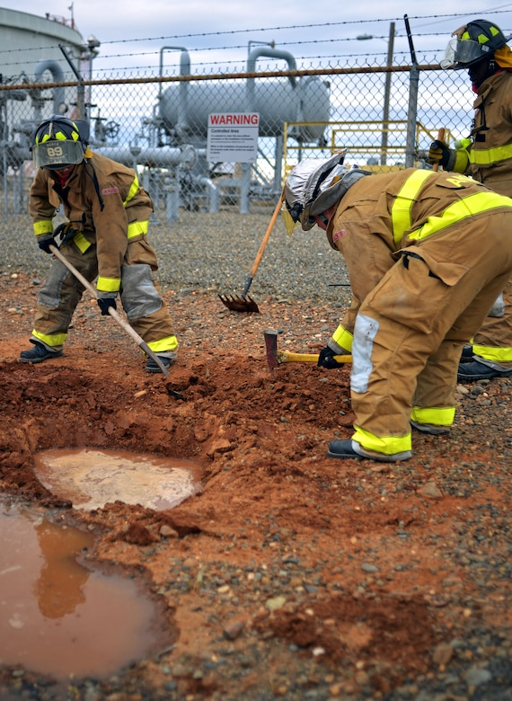 Firefighters from the 9th Civil Engineering Squadron work to contain a simulated JPTS fuel spill on Beale Air Force Base, Calif., March 28, 2013. (U.S. Air Force photo by Airman 1st Class Drew Buchanan/Released)